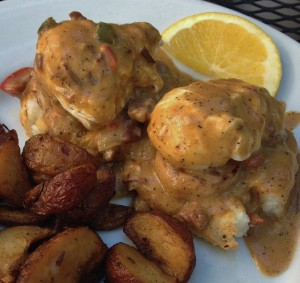Shrimp and Grit Benedict with breakfast potatoes