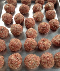 Raw meatballs all rolled out, waiting to be seared