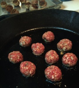 Searing the second batch of meatballs