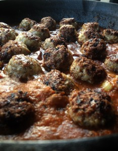 Close up meatballs with veggie sauce for mopping