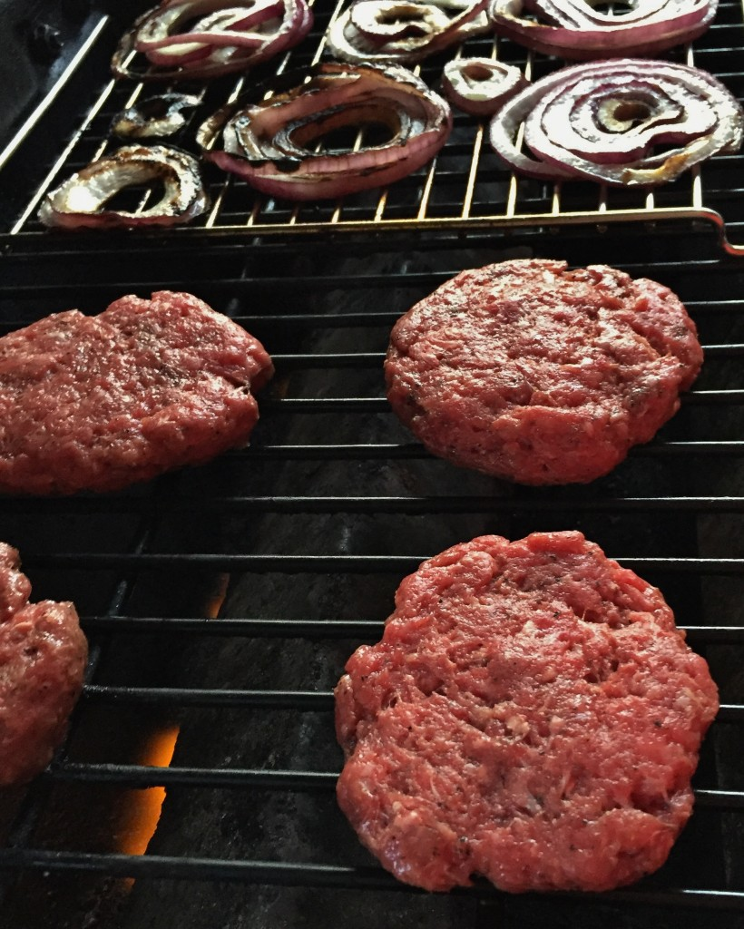 Burgers and onions grilling up