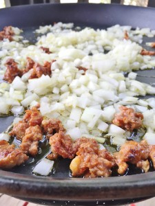 sizzling onions and chorizo