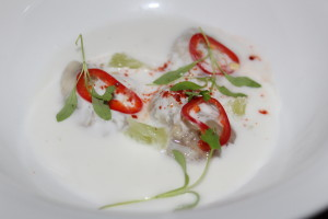 Oyster Kinilaw with lime, ginger, fresno chilis, coconut milk, and micro cilantro